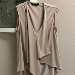 BCBG tan flowy sleeveless blouse. Sz XS like new!
